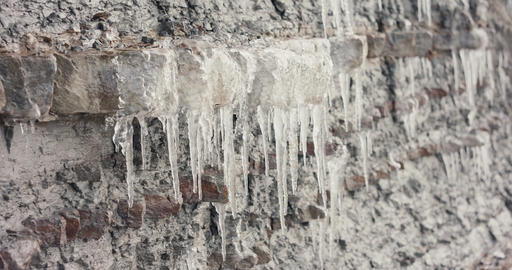 Icicles ice melts cliff meltdown spring or global warming slow motion Live Action