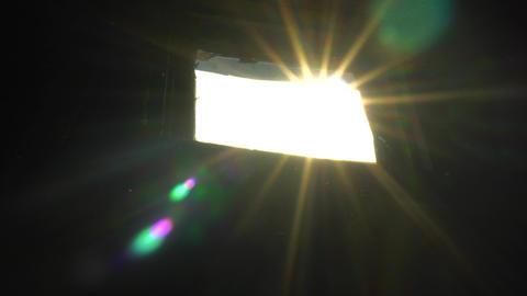 The Sun Breaks Through the Window into the Dark Room, the Sun's Rays Live Action