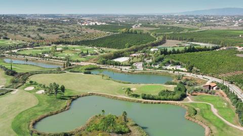 Albufeira, Portugal. Scenic tourist destination with grassy landscape and ponds Live Action