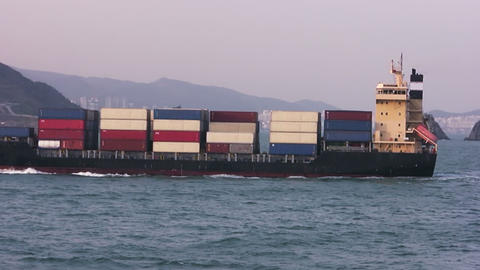 Container ship going in port Stock Video Footage