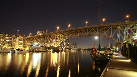 Time Lapse of Boat moving by Granville Bridge. Vie Stock Video Footage