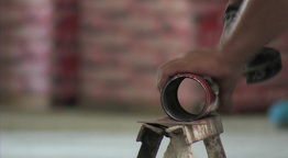 Grinder bricklayer cuts a tube Footage