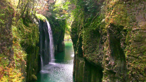 Rocks and spring waterfall Stock Video Footage