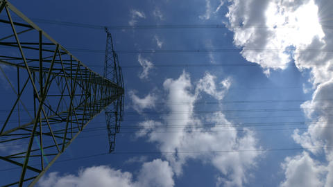 4k UHD electricity pylon time lapse zoom 10883 Stock Video Footage