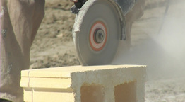 Bricklayer cutting a brick with grinder Footage