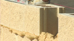 Bricklayer putting brick Footage
