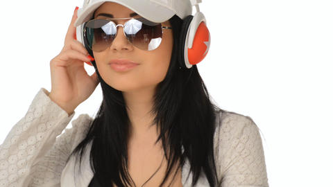 Beautiful girl listening to music and laughs Stock Video Footage