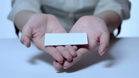 名刺を渡す若い女性 stock footage