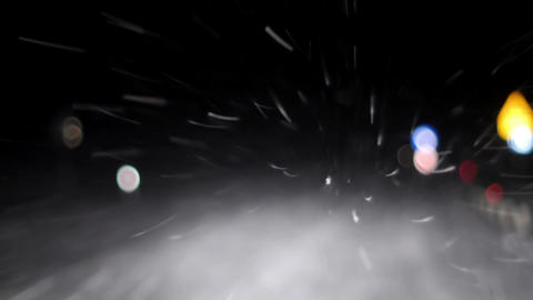 Driving a car during snowfall at night Footage