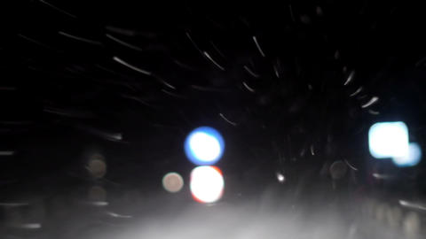 Driving a car during snowfall at night Stock Video Footage