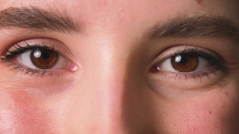 Close up of Womans eyes, Girl opening her Beautiful brown eyes. Natural Beauty Live Action