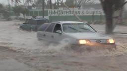 Hurricane Flooding - cars taking risky road undewater Footage