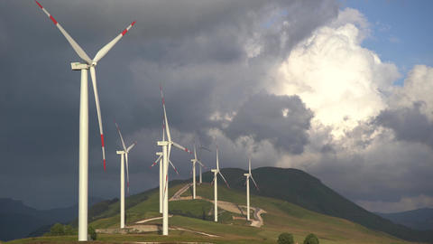 Huge high wind turbines on the hill, against the backdrop of an epic sky. Wind Live Action
