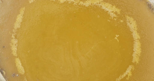 Rotation of natural beeswax. Close-up. Natural beeswax melted from honeycomb Live Action