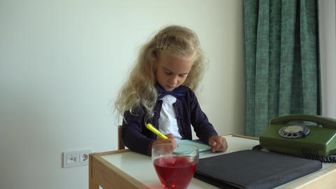 Female child girl pretend play secretary. Child sit by table with retro phone Live Action