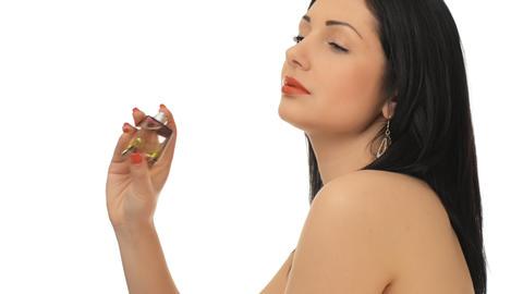 Young beautiful girl perfume and flirts Footage