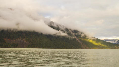 Foggy Morning with Sun Light Shining on a Mountain Stock Video Footage