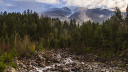 Misty Clouds on a Snowy Mountain Top and River Run Footage