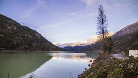 Sunset Light Reflection on Mountain by Lillooet Lake Live Action