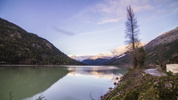 Sunset Light Reflection on Mountain by Lillooet Lake Stock Video Footage