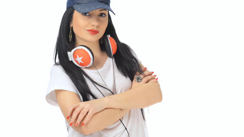 Beautiful girl dancing with cap and headphones Stock Video Footage