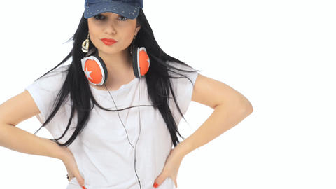 Beautiful girl dancing with cap and headphones Footage