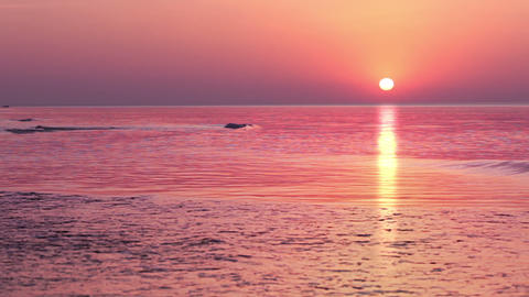 Multi-colored sunrise over the surf Stock Video Footage