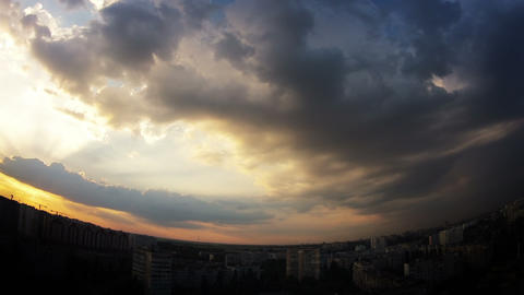 Dramatic multi-colored sky over the city. Timelapse Footage