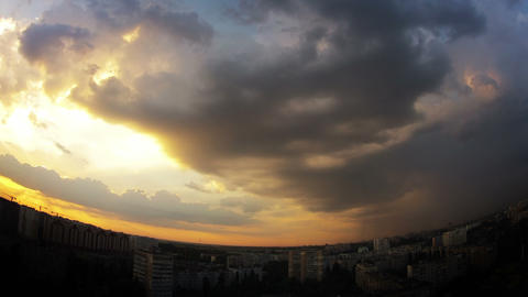 Dramatic multi-colored sky over the city. Timelapse Stock Video Footage