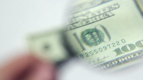 close-up authentication of one hundred dollars ban Stock Video Footage