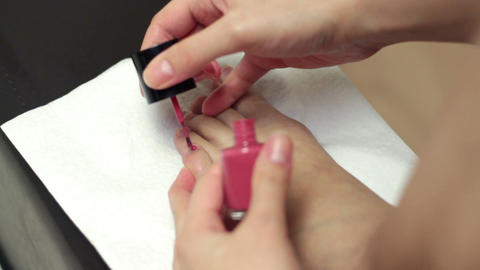 girl applying enamel on feet fingernails at home Stock Video Footage