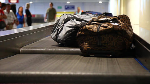 Airport baggage belt with moving luggage Stock Video Footage