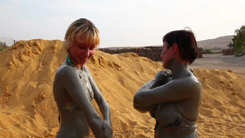 Two women make the mud therapy Footage