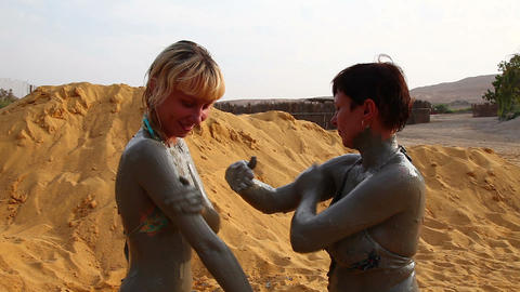 Two women make the mud therapy Stock Video Footage