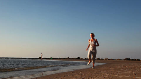 Girl jogging along a Beach Footage