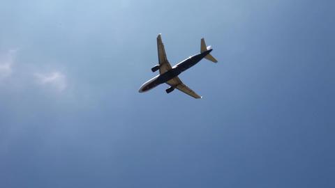Plane flies in the sky Stock Video Footage