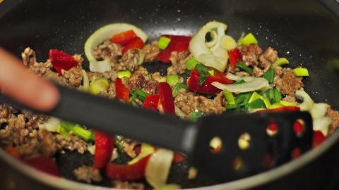 Preparing dinner. Frying meat with vegetables Stock Video Footage
