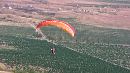 Paraglider over the coastline Stock Video Footage