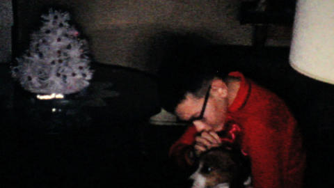 Boy Gets New Puppy For Christmas 1960 Vintage 8mm film Stock Video Footage