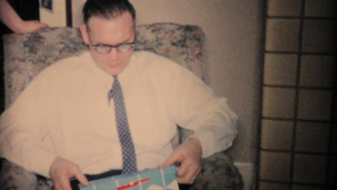 Man Gets Shaving Kit For Christmas 1960 Vintage 8mm film Stock Video Footage