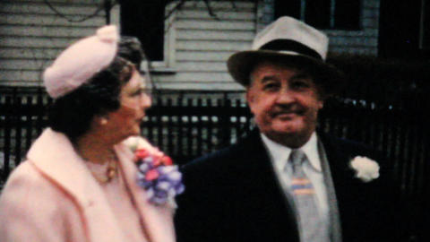 Wife Fixes Husbands Hat On Easter 1957 Vintage 8mm film Stock Video Footage