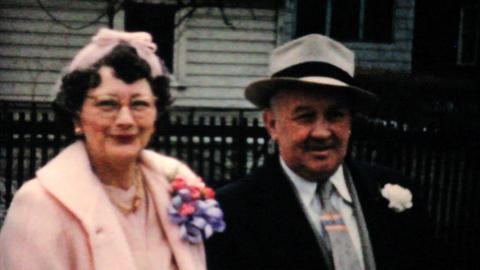 Wife Fixes Husbands Hat On Easter 1957 Vintage 8mm film Footage