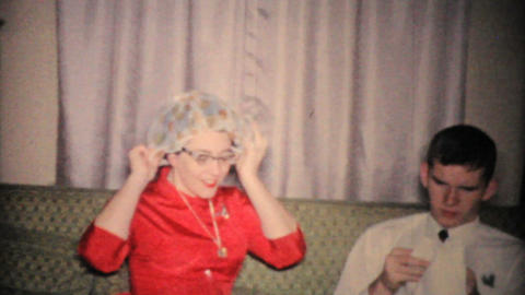 Woman Tries On Shower Cap At Christmas 1957 Vintage 8mm film Stock Video Footage