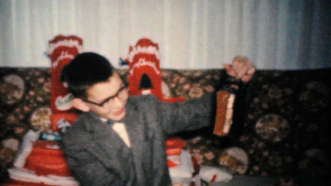 Young Boy Gets Toys For Christmas 1960 Vintage 8mm film Stock Video Footage