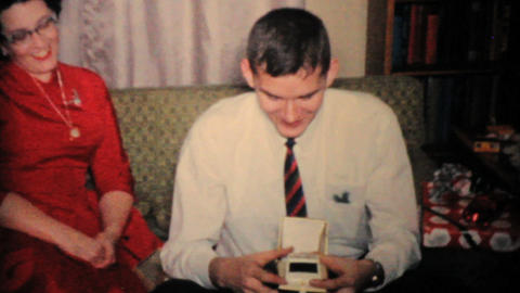 Young Man Gets New Shaver For Christmas 1960 Vintage 8mm... Stock Video Footage