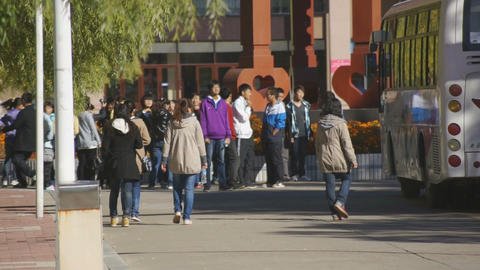 Chinese students and a bus Stock Video Footage