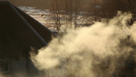 Smoke coming from chimney at sunset 2 Stock Video Footage