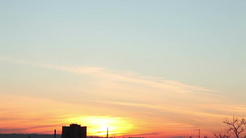 Time-lapse of clouds at sunset over the city 15 Stock Video Footage