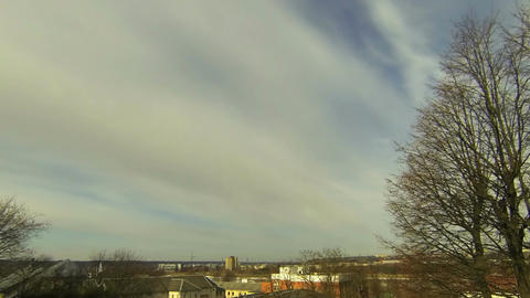 Time-lapse of midday clouds over the city 1