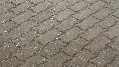 Time-lapse of snow falling on a pavement 1 Stock Video Footage